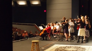 Watching the musicians at work from the wings: Bob and Pam Byers hiding on the far left