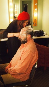 The first morning: being measured for the wig